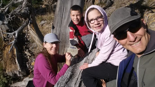 Pioneer Cabin: finding a geocache with my husband and children.